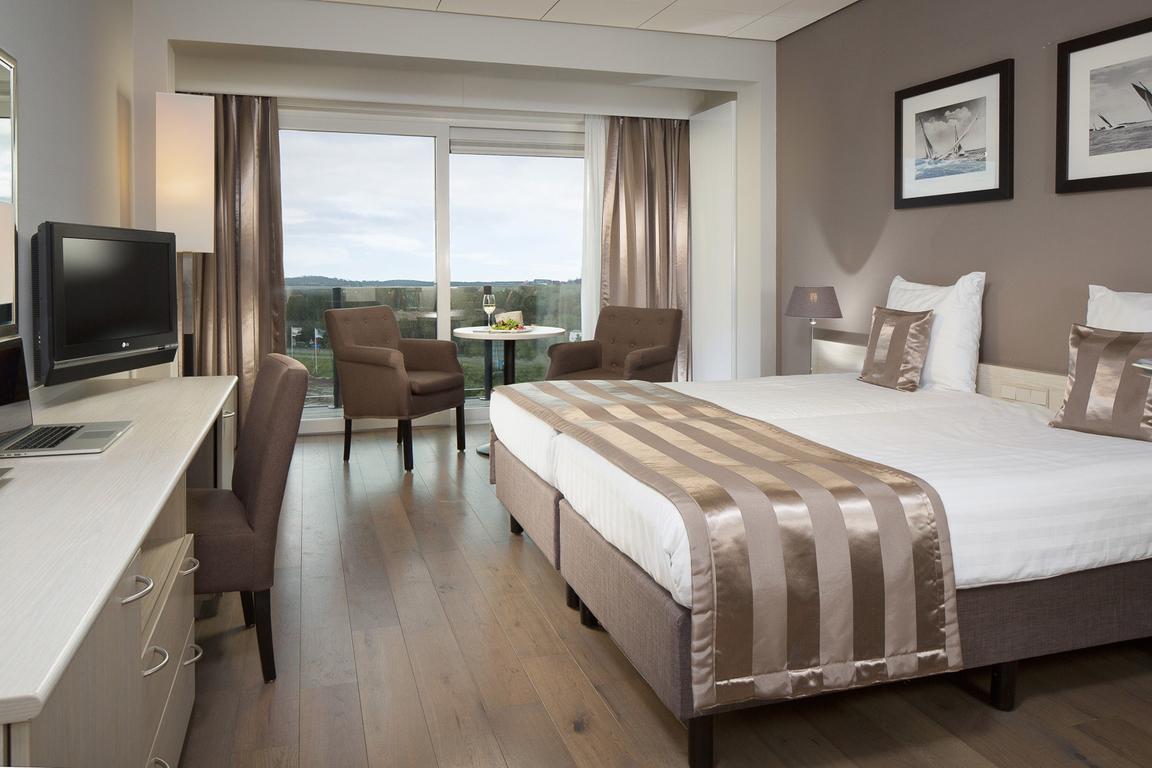 Superior-Doppelzimmer mit Landblick: Komfort und Luxus im Hotel de Blanke Top Cadzand-Bad